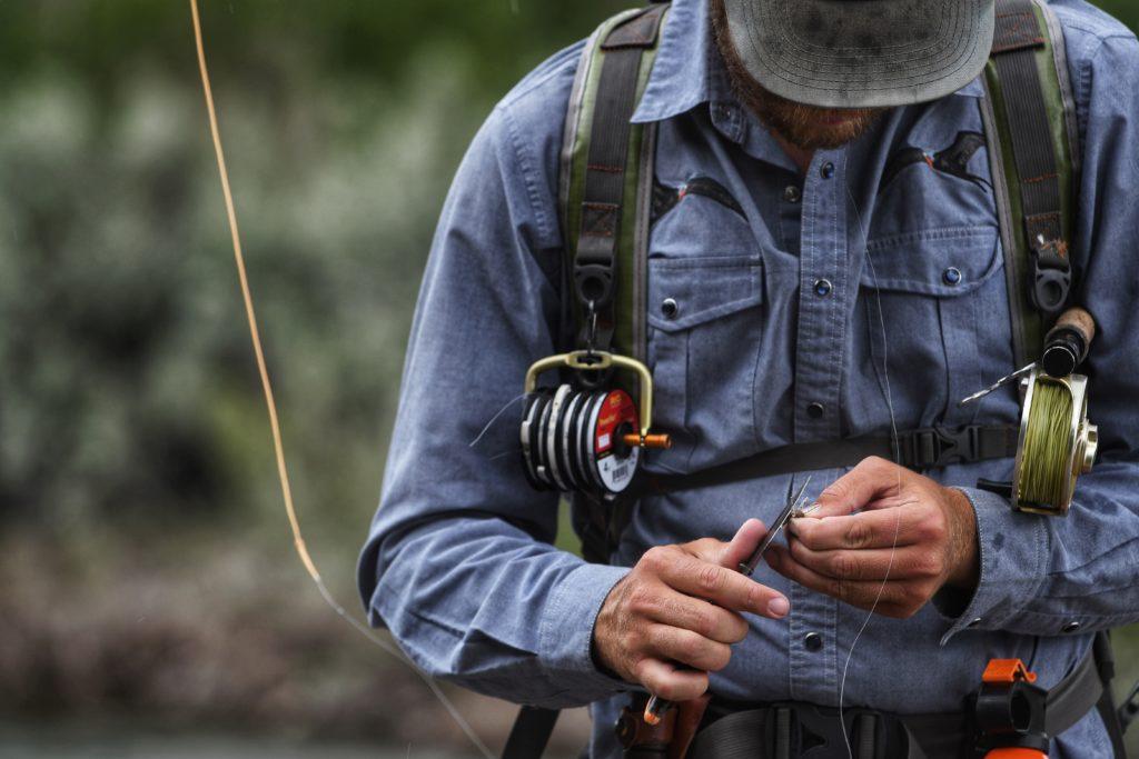 Fisherman using fishing knives